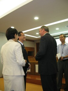 Speaker greeted by Director Public Services Macao
